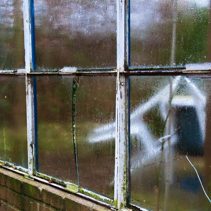 Window onto a broken garden